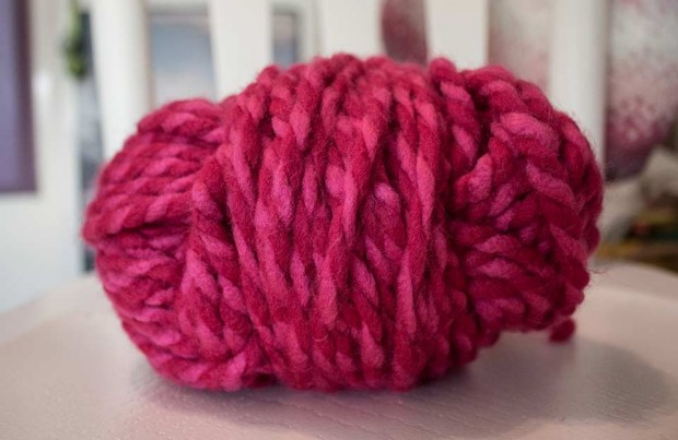 one skein of chunky pink/red yarn